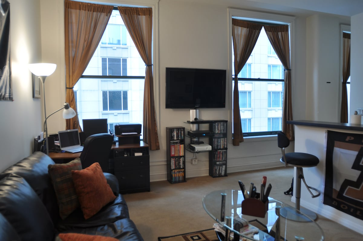 "Spacious living room with a 46"" HDTV, desk, and seating for plenty; full desk and hi-speed internet access for business travelers"