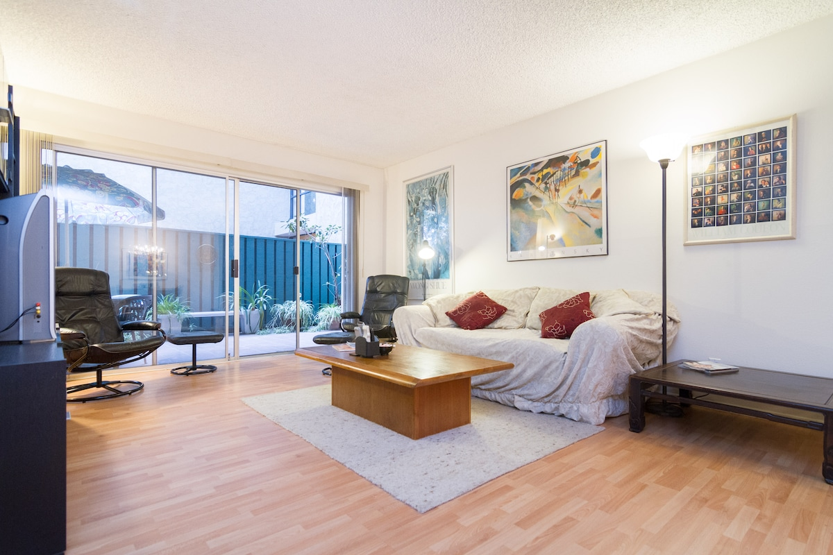 The fully furnished condo features an unusually large living room, a private veranda, and lots of SoCal sun!