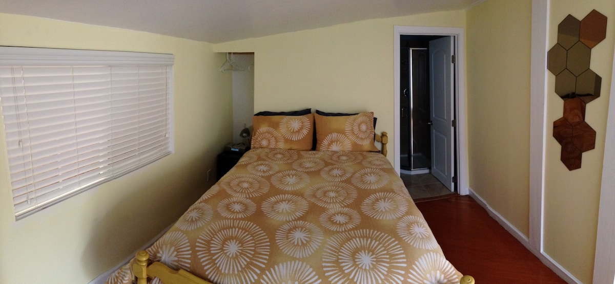 Our nice big full size bed. And the closet right next to you with a mini fridge.