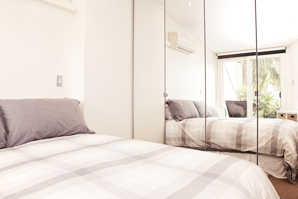 The rented bedroom - with mirrored built-in wardrobe, and direct access to the outdoor terrace.