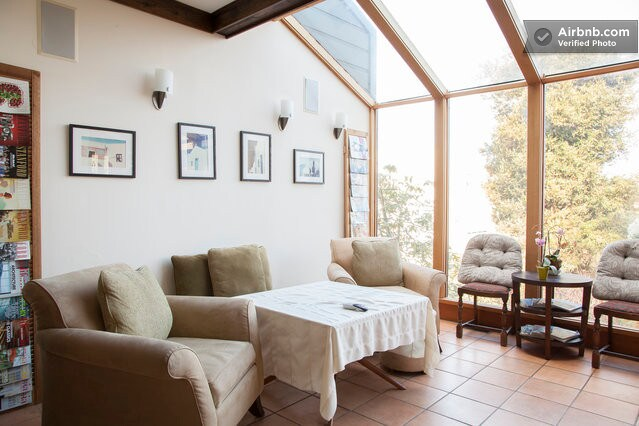 Glass atrium with surround sound and cable TV, but we suggest that you enjoy the view!!!