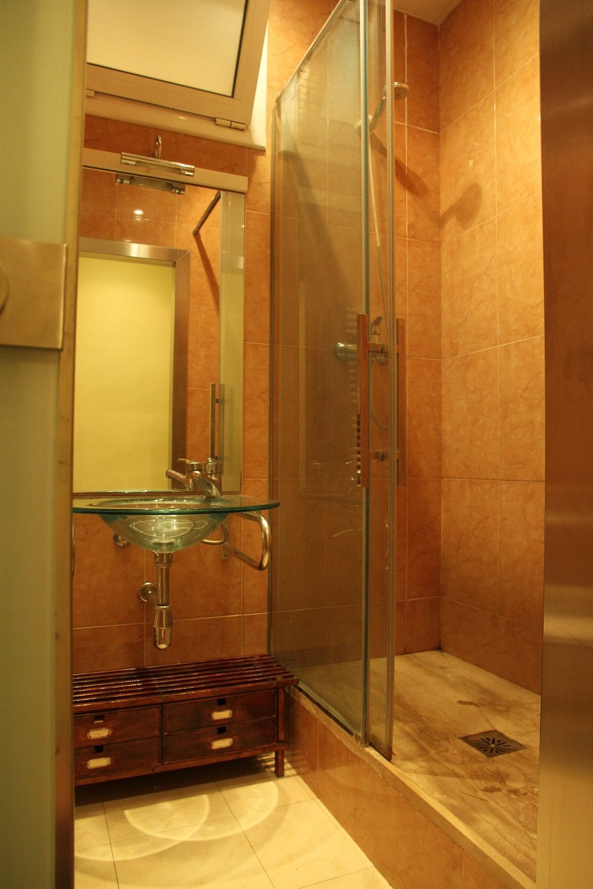 Nice, large, walk-in shower...do not worry about liquids at the airport; we provide shampoo and gel!