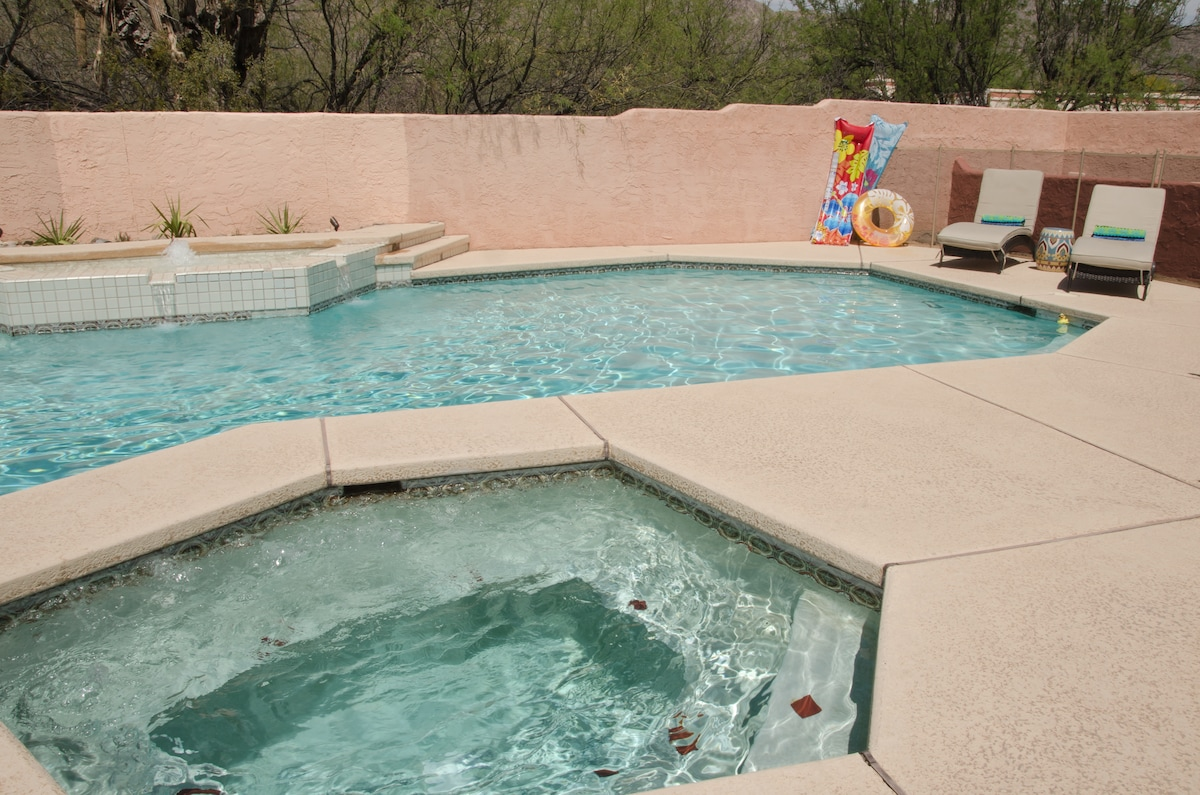 Pool with spa, spacious area with new plantings, pool floats and ample sunning areas.