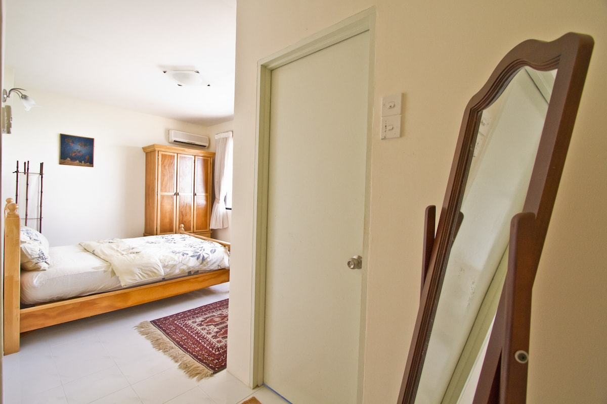 The master bedroom with attached bathroom  with full sea view is for my guests.