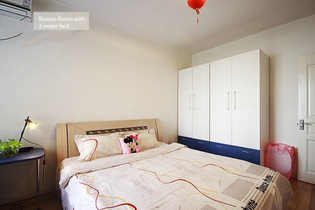 Two meter king size bed and full-length mirror