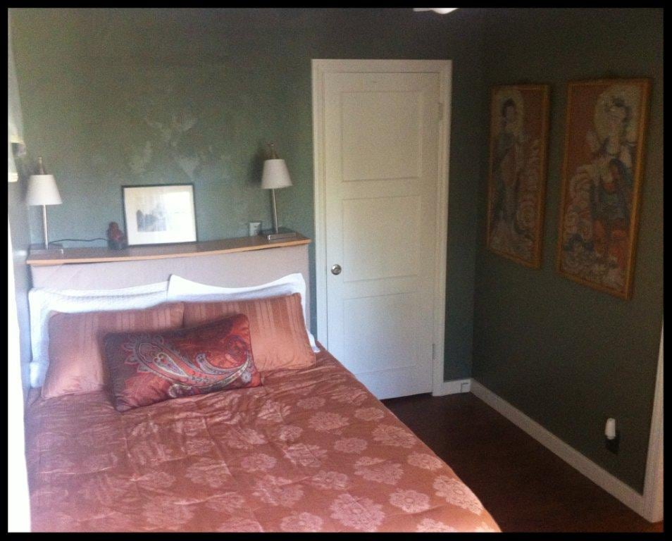 Bed, with closet and vintage chinese artwork on the walls