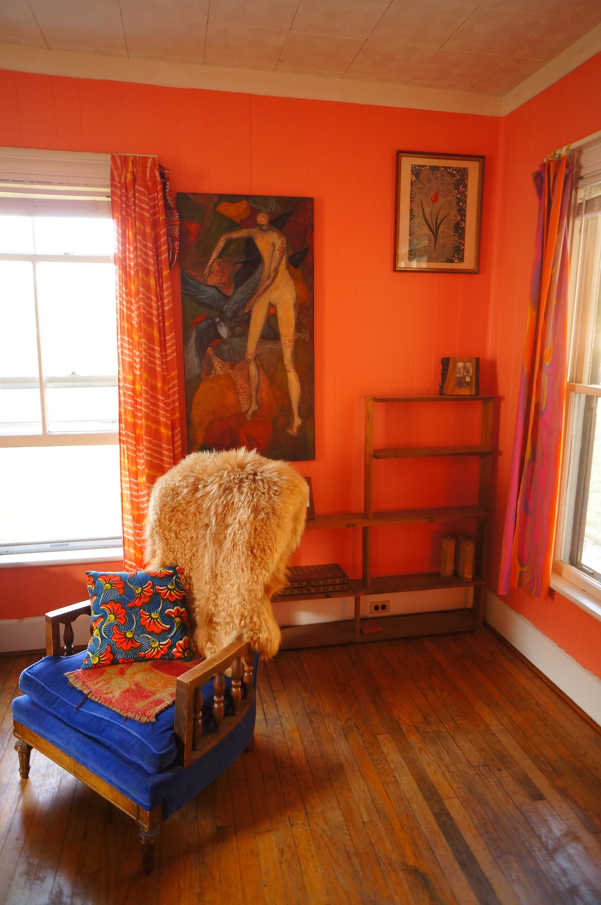 Chair with angora goat fur draped and my grandfathers backgammon board.
