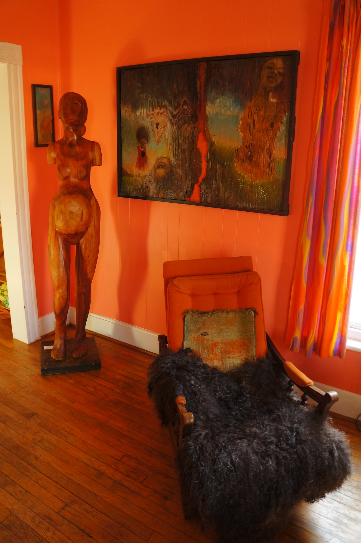 Chair with angora goat fur and my grandmothers small deer carpet.