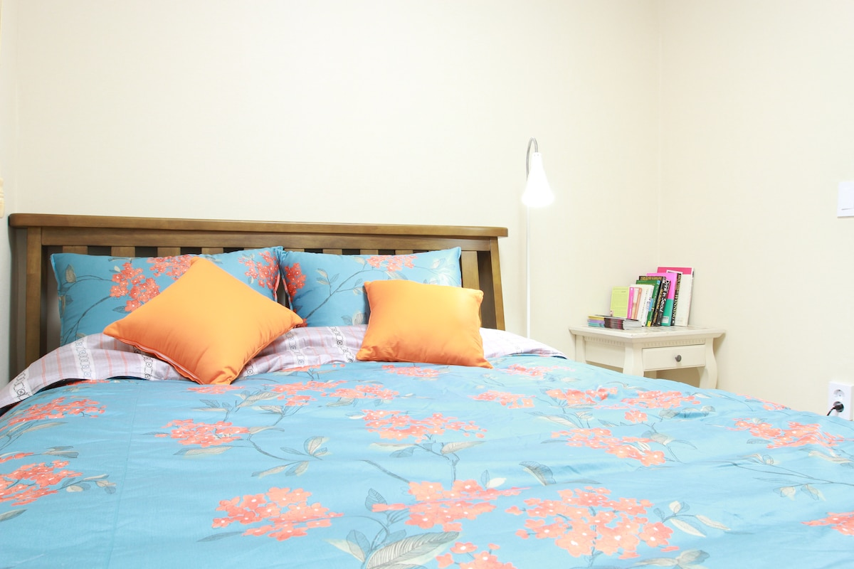 Cozy bedroom-King sized bed with fluffy pillows and comfortable mattress for a great night of rest.