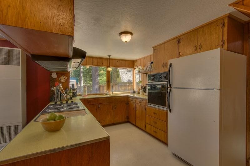 large kitchen with microwave, oven, dishes, cooking/bakeware, toaster, crock pot, coffee maker, rice cooker, condiments, salt/sugar, rice, etc