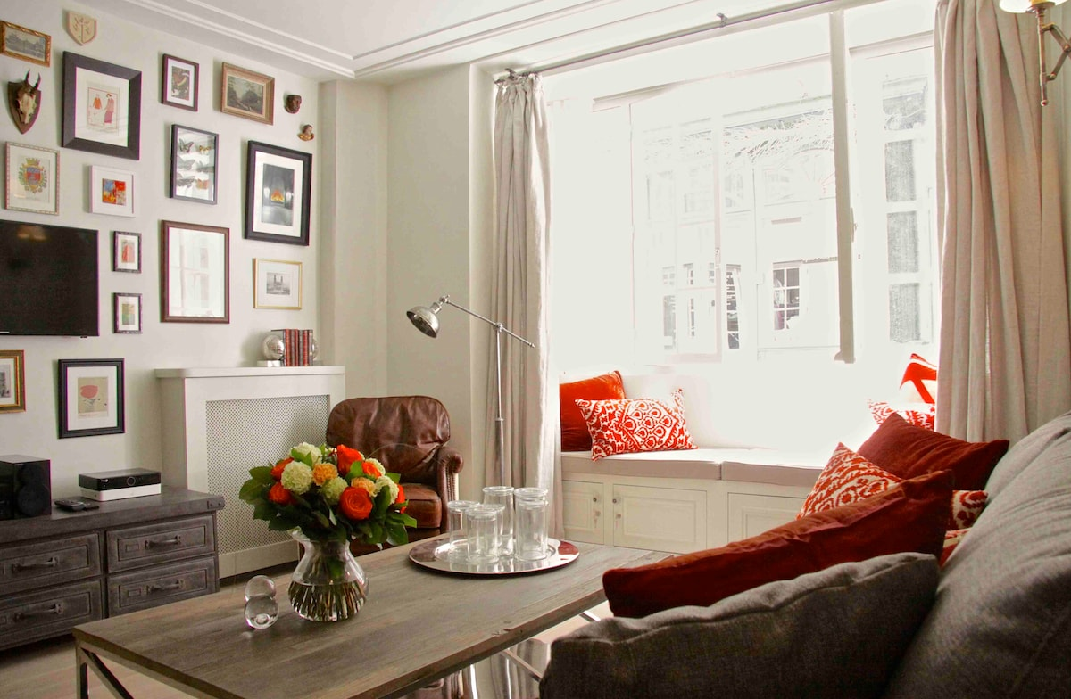 A divinely decorated room is your living room with a view to 16th Century Paris!