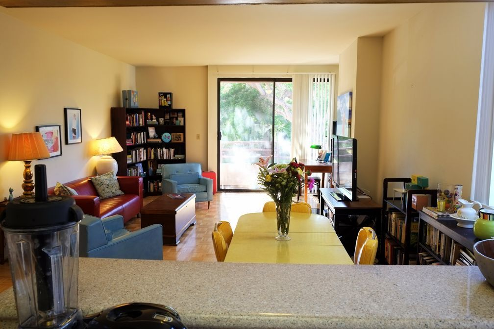 View of common area from kitchen. Chris's corner office with a view.