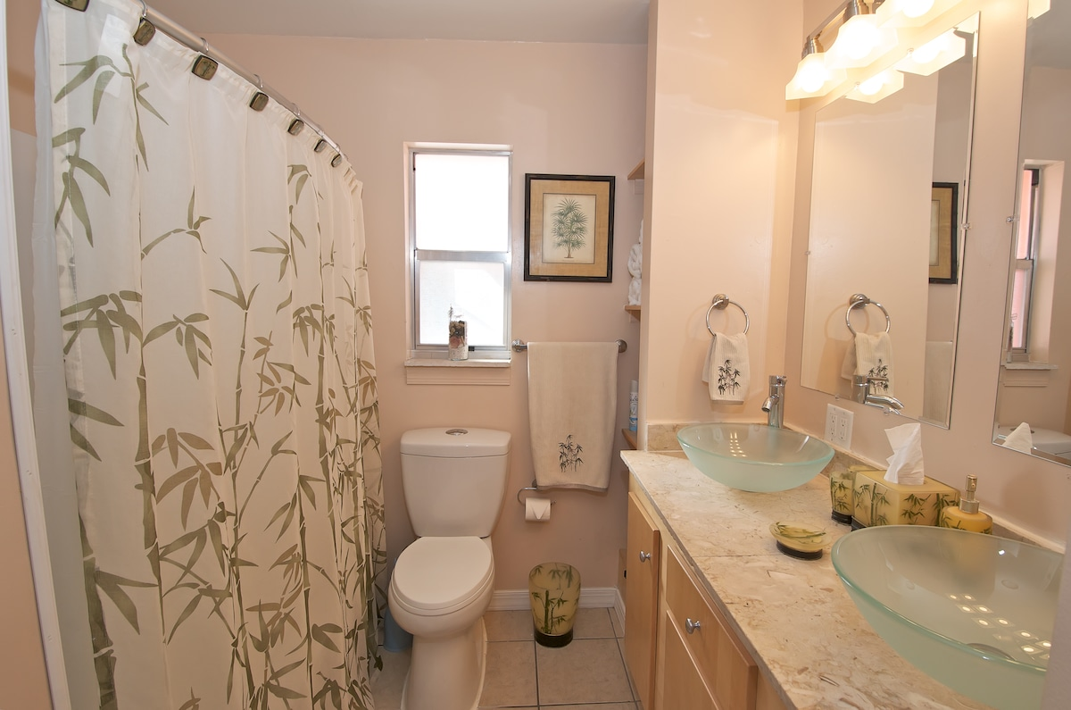 Luxury double vessel sinks, stone counter, comfortable bath/shower and plenty of storage