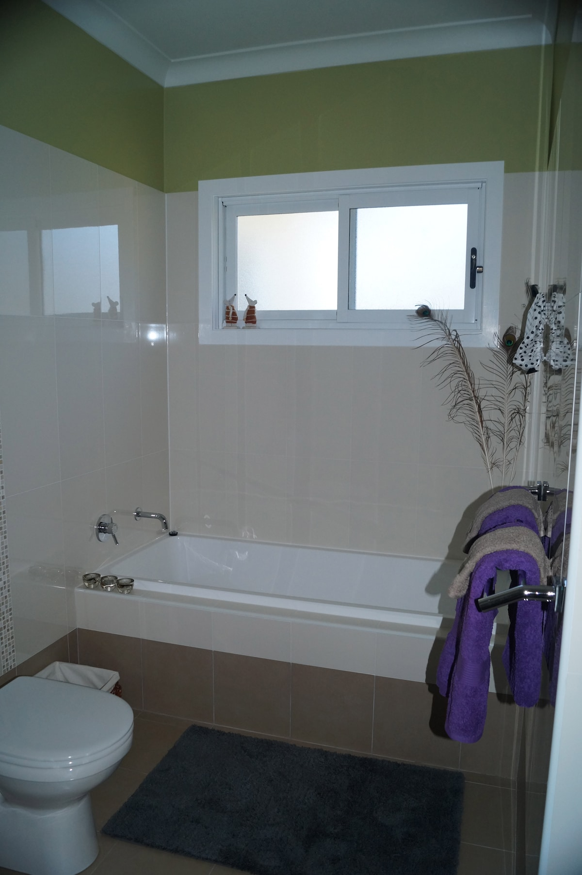 A great bath for a soak after a hard day's leisure and candles for mood lighting too!