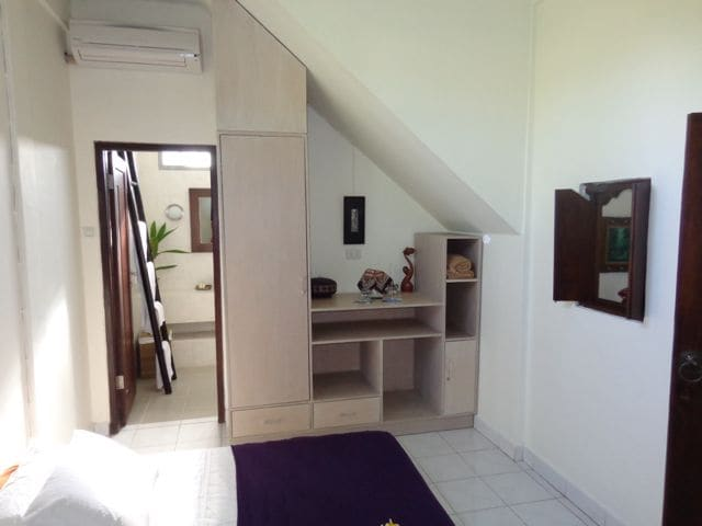 Built in robes, lockable cupboard and lots of hanging and storage. Jepun bedroom suite.