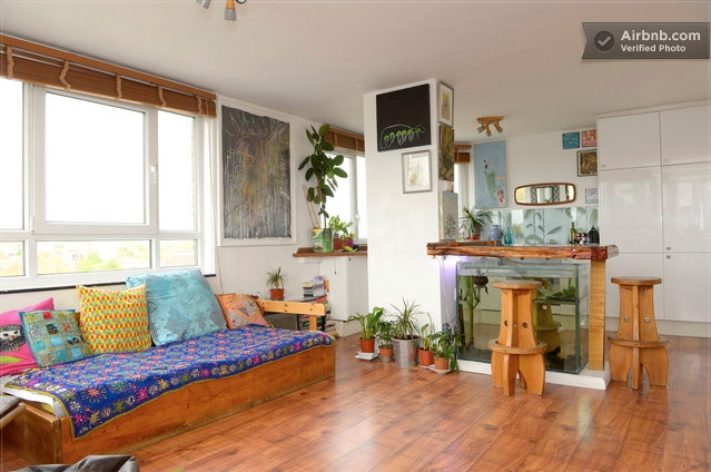 Living space with handmade artisan furniture, original artworks and aquarium table!