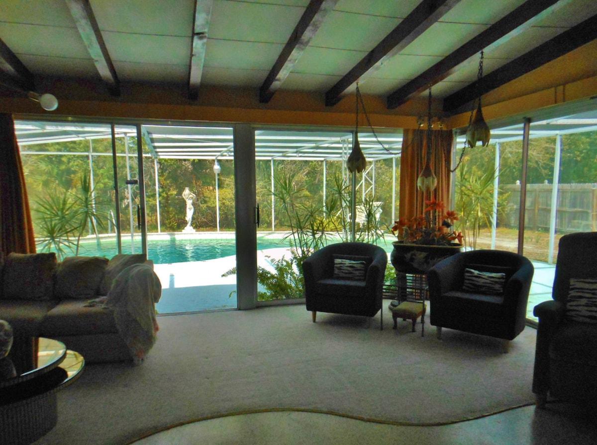 Sliding glass doors offer pool views