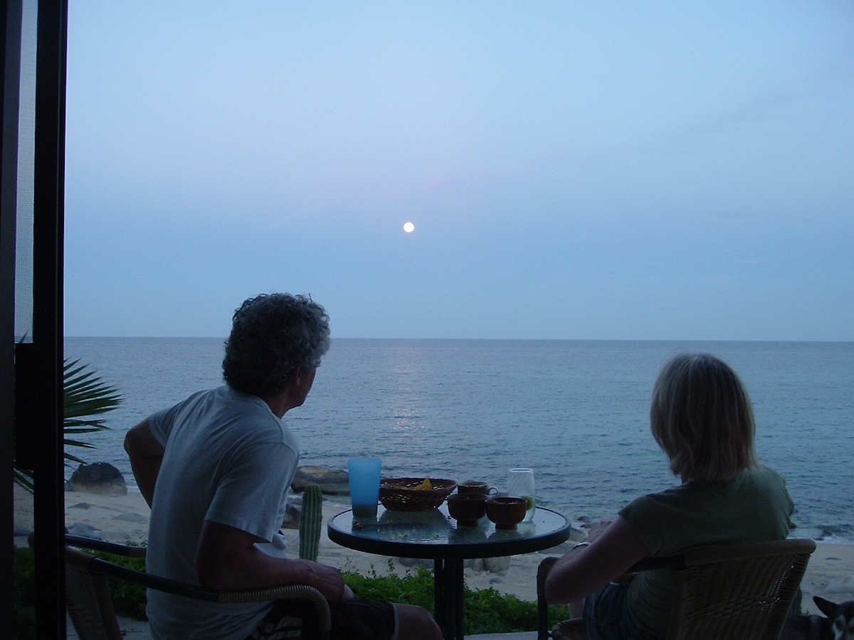 Clair and Richard enjoying dinner and moonrise over the Sea of Cortez from the porch