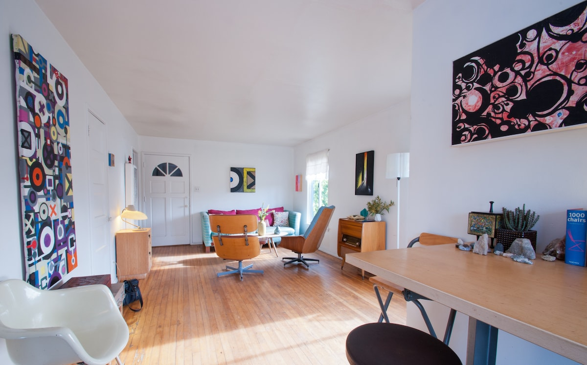 Living room and creative work or dining area