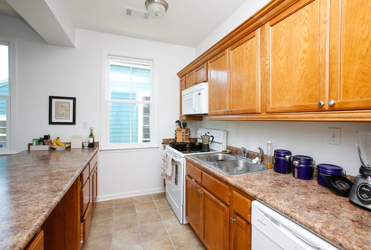 Shared kitchen, with your own shelf space for storing snacks.
