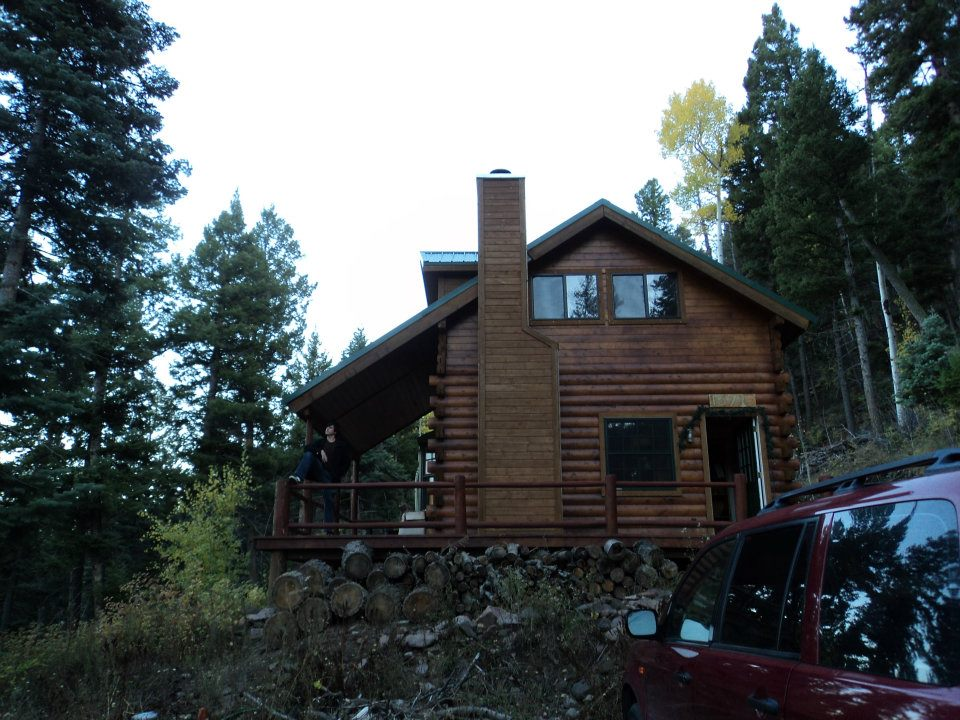 Cabin in summer.  Nestled in the aspen and pines of the Rio Grande National Forest.  Property sits on six acres and backs up to the forest.  Hilltop views from porch of the canyon below.