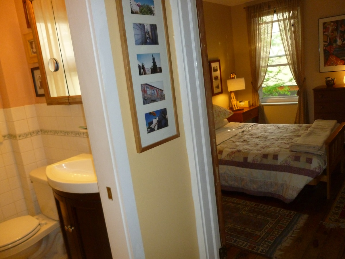 Guest bathroom is just outside bedroom