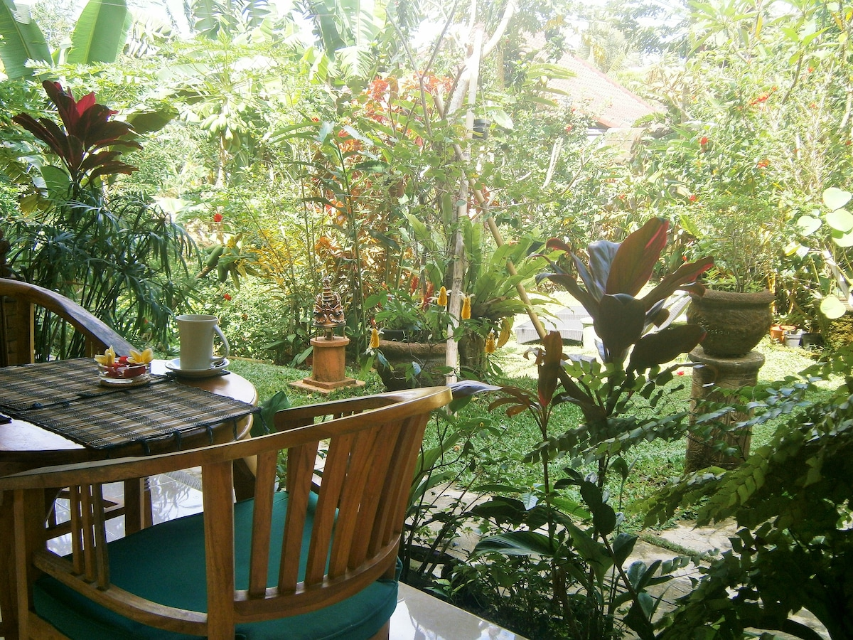 Your balcony overlooks the tropical garden