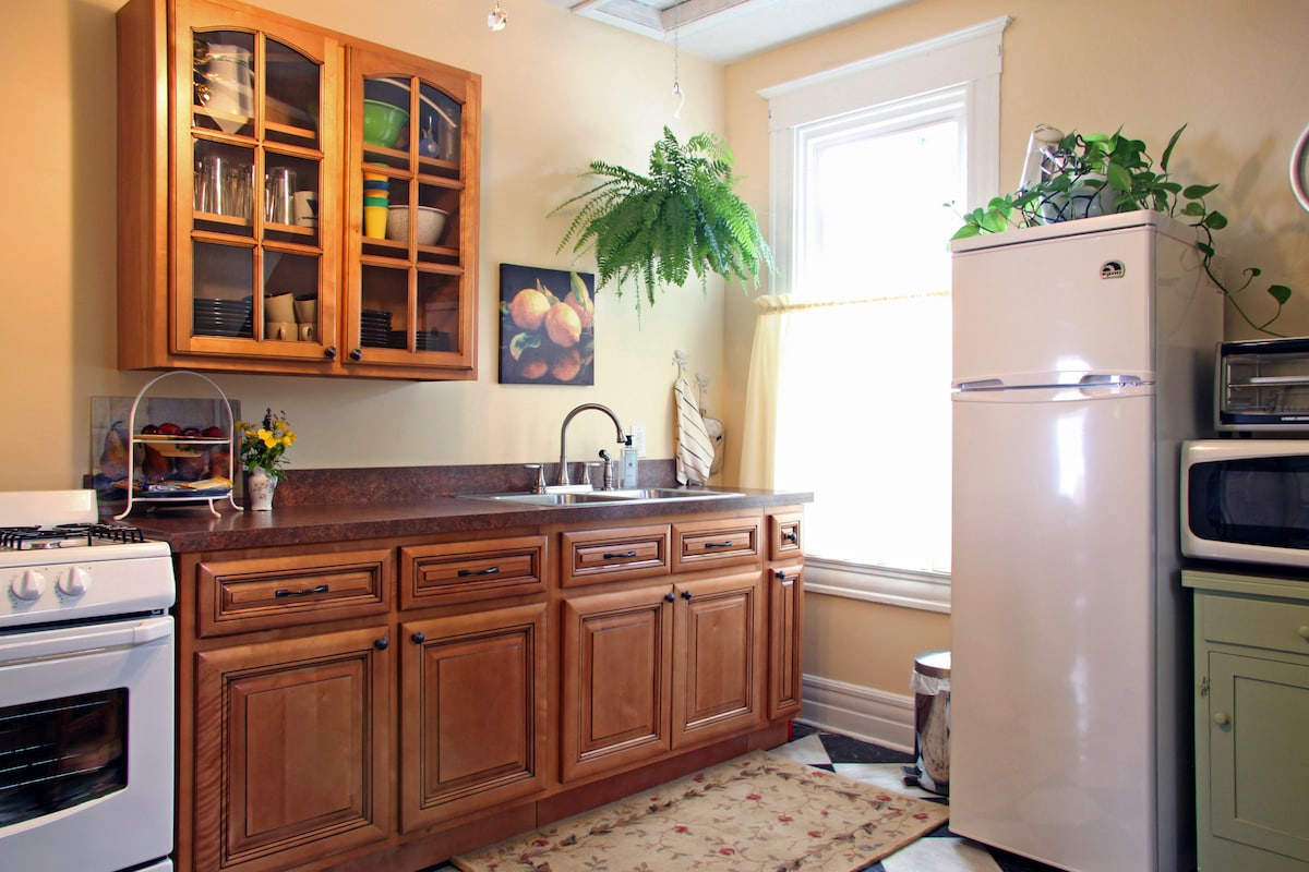 Our new kitchen is fully stocked with dishes, silverware, and pots and pans, as well as breakfast and snack items.