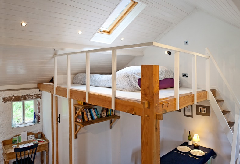 Mezzanine sleeping area with bathroom and  dining area beneath