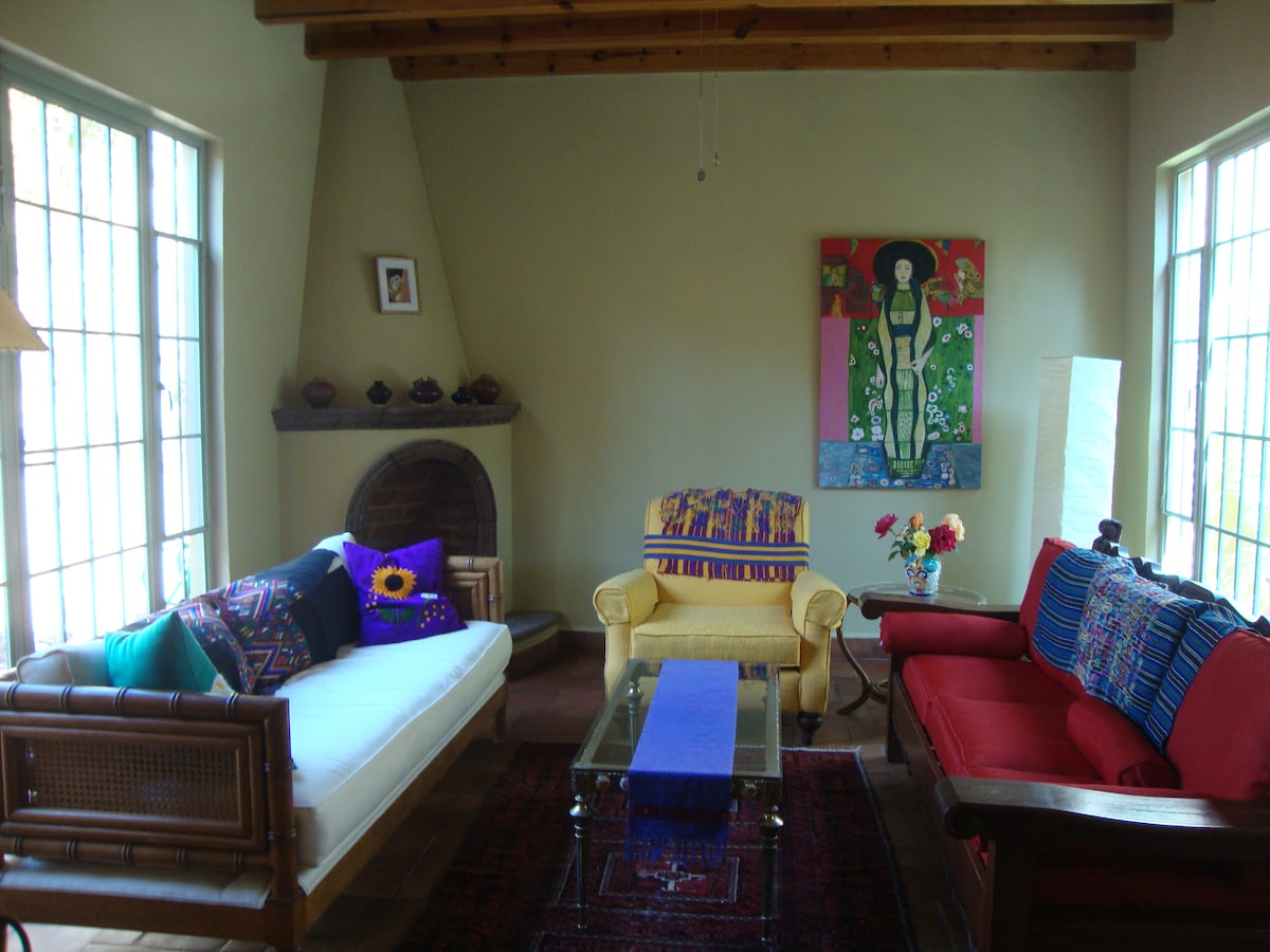 "Colorful Mexican Living room or Sala, with gas Chimenea.  Two sofas double as extra ""beds""."