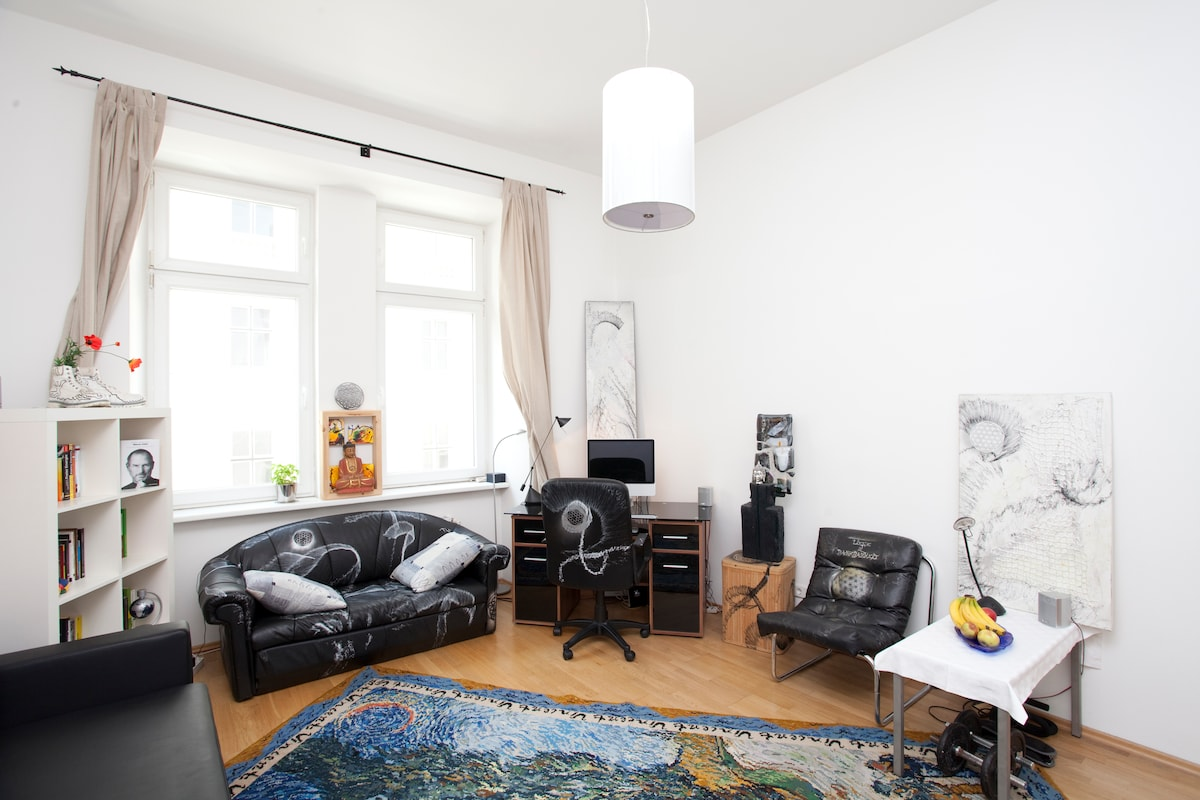 the living room: bookshelf, couch, desk, glass work, chill chair and always fresh fruits