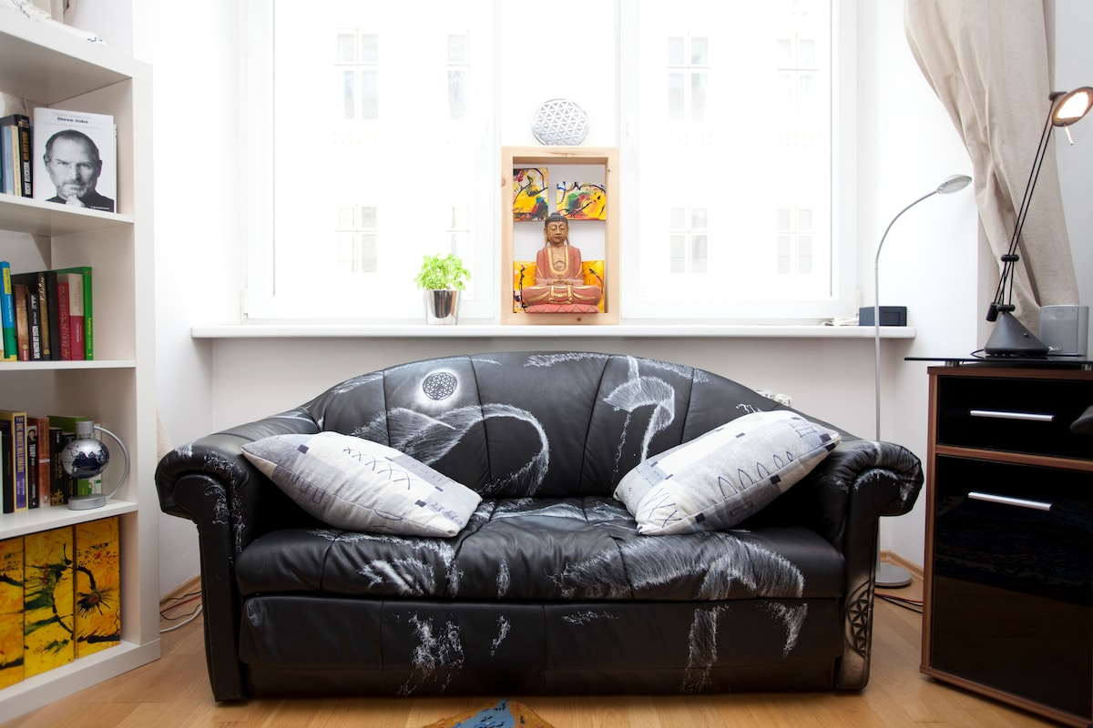 Buddha keeps the sleeping couch under surveillance