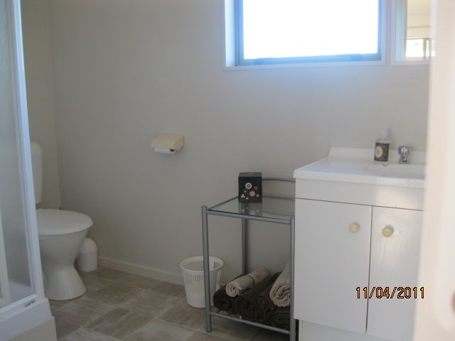 Combined shower,toilet and vanity.