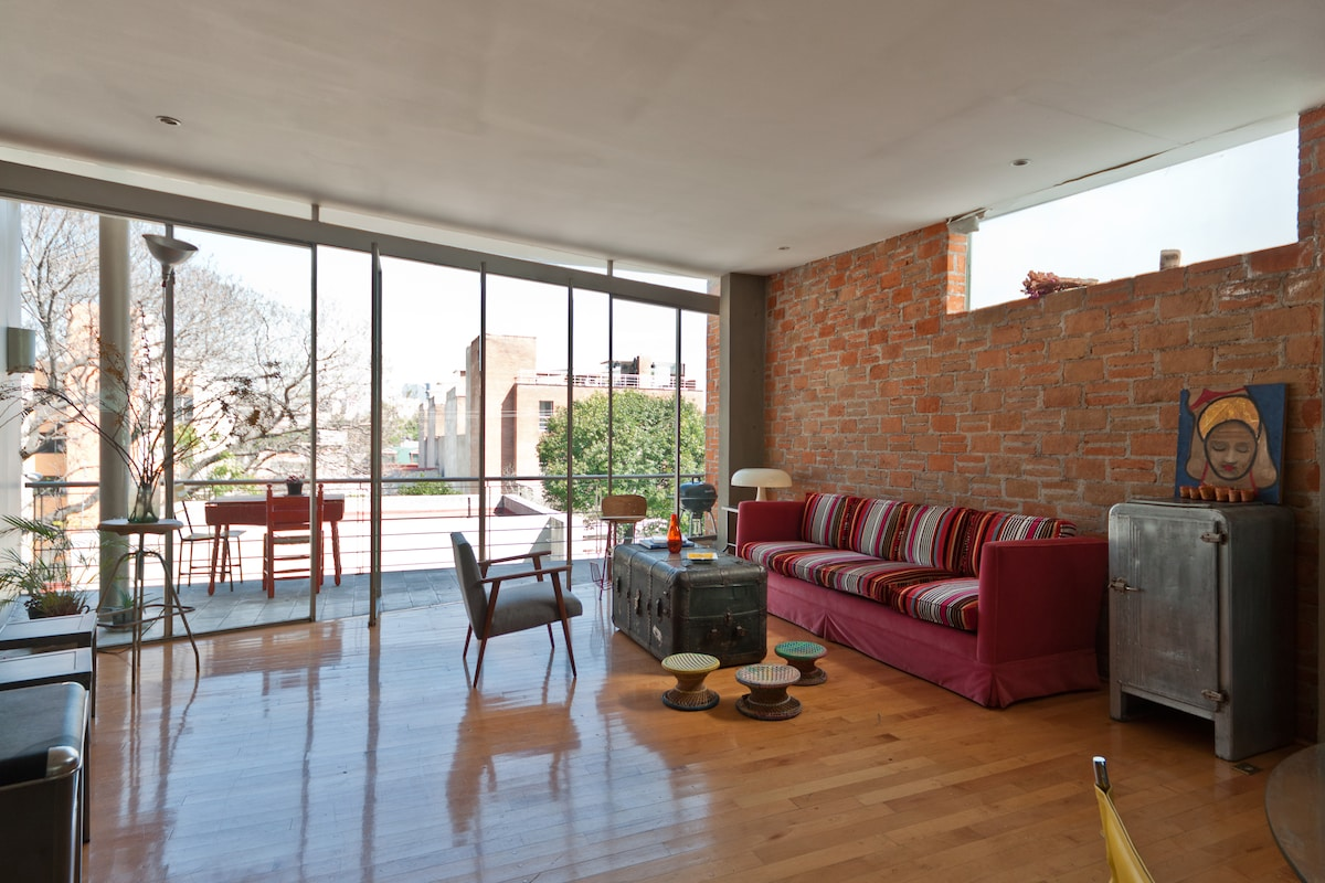 We love the huge space and light of our appartment... Let us show you around.