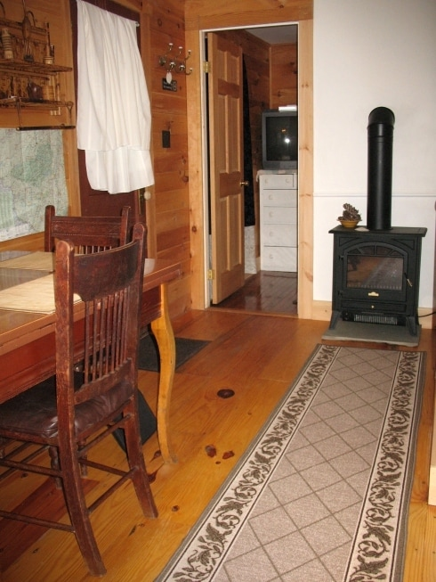 Dining area.  (Table, electric wood stove)