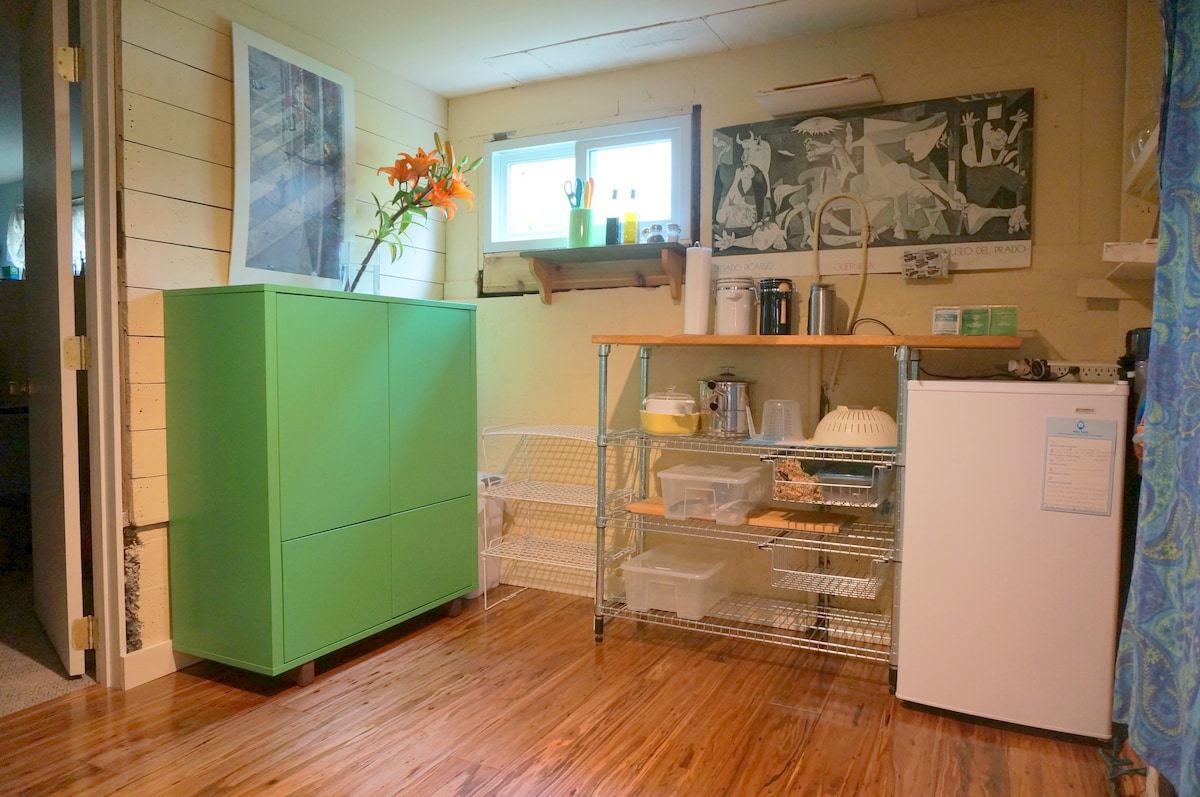 The kitchenette with a small refrigerator, a cabinet full of dishes, utensils, napkins, coffee/decaf, tea, and oatmeal so that you can prepare a quick breakfast.