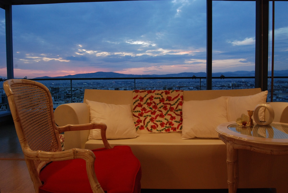 Sitting area overlooking the whole city of Athens