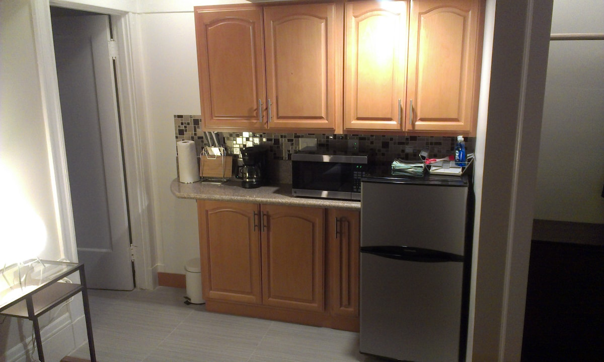 Kitchenette with microwave, toaster, and coffeemaker.