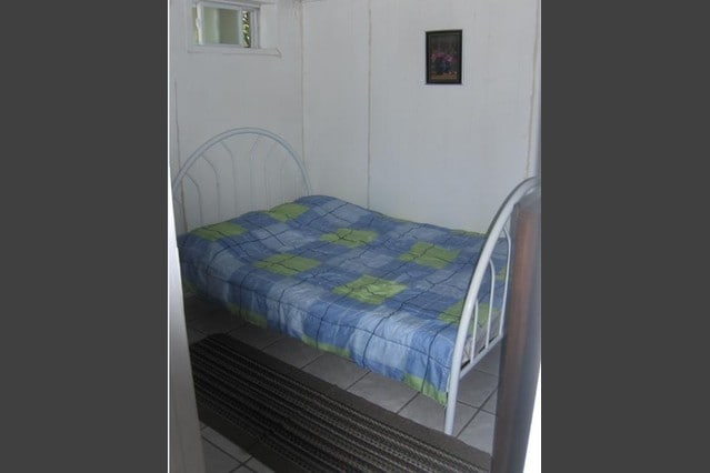 Queen bed for couple - complete with comforter, bed linens, bed cover, pillows. Has window for fresh air
