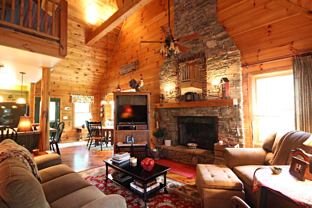 Cozy Living area with stone fireplace