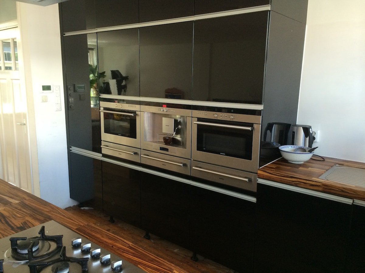 The kitchen has everything you need because we really love to cook. You can use all equipment (from steam oven to kitchen aid but ofcourse also micro wave, oven and furnace), and also our pots and pans and all kitchen garments.