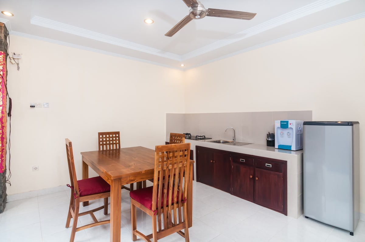 Private kitchenette, complete with refrigerator, stove, dishes, drinking water and dinning table.