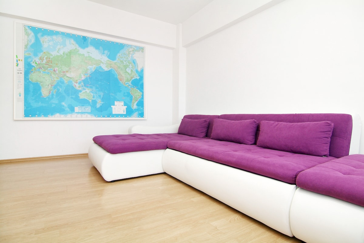Comfy extendable sofa and king size world map