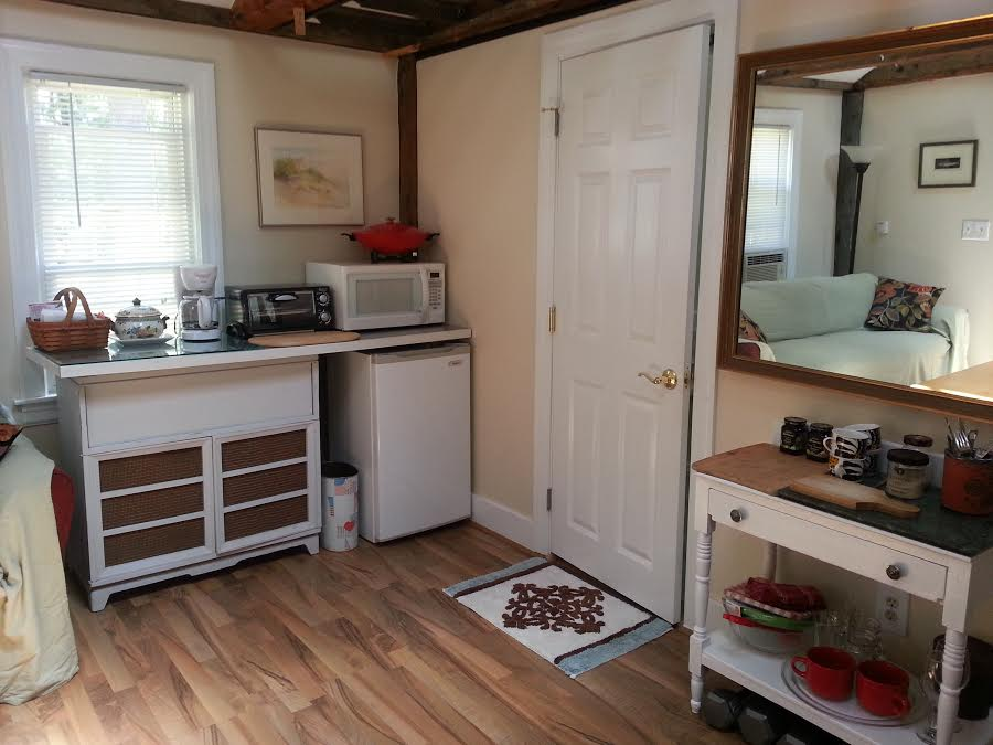Microwave, brand new convection toaster oven, electric wok, small refrigerator, dishes and glasses - see new photo of kitchen area below