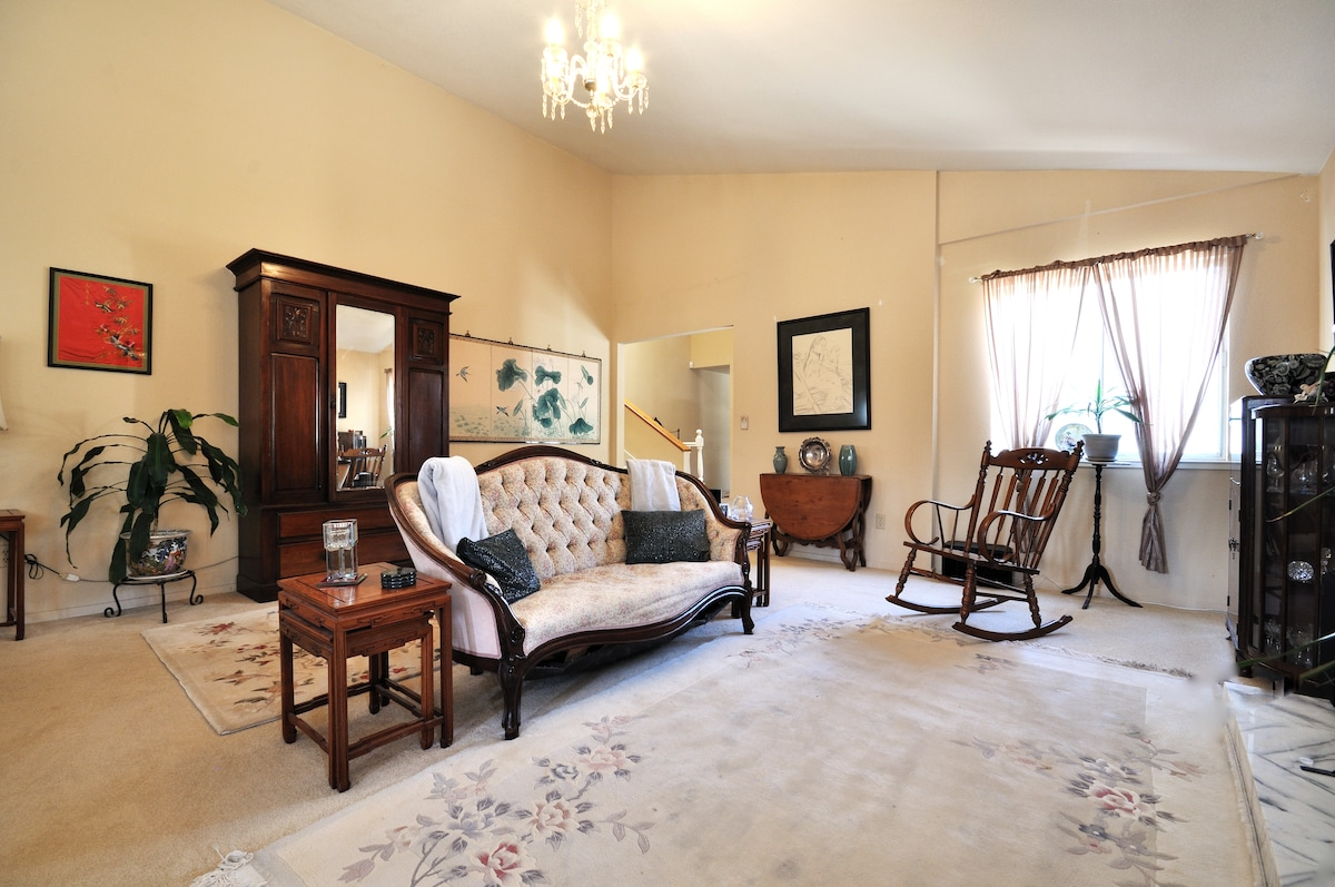 Antiques are the primary style of furnishings in our 400 square foot living room.