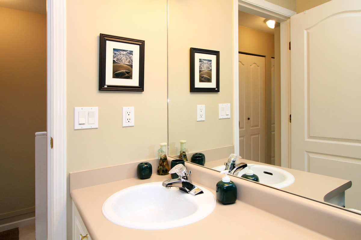 Private bathroom with tub and shower.