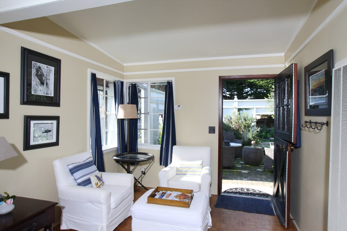 Comfy seating area, Dutch door opens to private patio