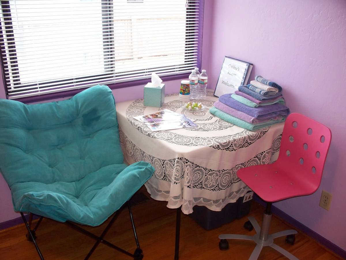 Room #1, Gabby's room:  in the window corner of the room is the table (with amenities) and the butterfly chair.