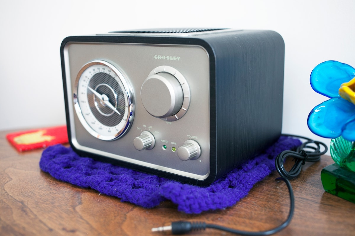 A Crosley radio always tuned tuned to New Orleans' own WWOZ 90.7 FM.  Or plug in a device to listen to your tunes.