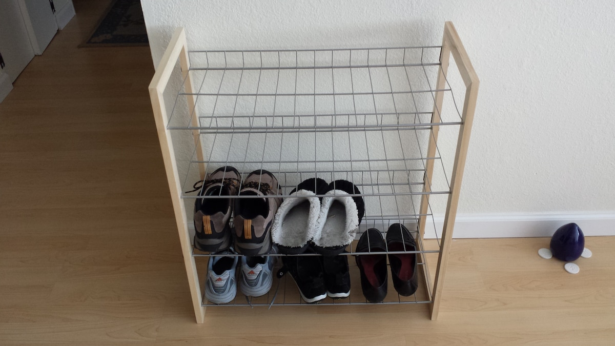 Shoe rack to help keep the apartment clean!